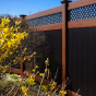 black-and-wood-grain-vinyl-pvc-fence-illusions-vt