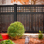 Gorgeous Black PVC Vinyl Semi-Privacy Fence with Old English Lattice and Three Inch Boards by Illusions Vinyl Fence. #fenceideas #homeideas #backyardideas #fence