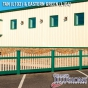 V352-4TR Picket Vinyl Fence with Dog Ear Caps in Eastern Green (L104) and Tan (L102)