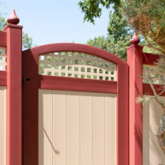 red and tan pvc vinyl accent gate and fence from illusions fence