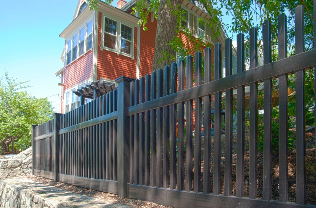 Need a black vinyl PVC picket fence? This terrific photo shows how comfortable this black vinyl pvc picket fencing panel fits in for that cozy New England or San Francisco styled look. Available in 35 colors and authentic wood grains as well. #fenceideas #homeideas #yardideas