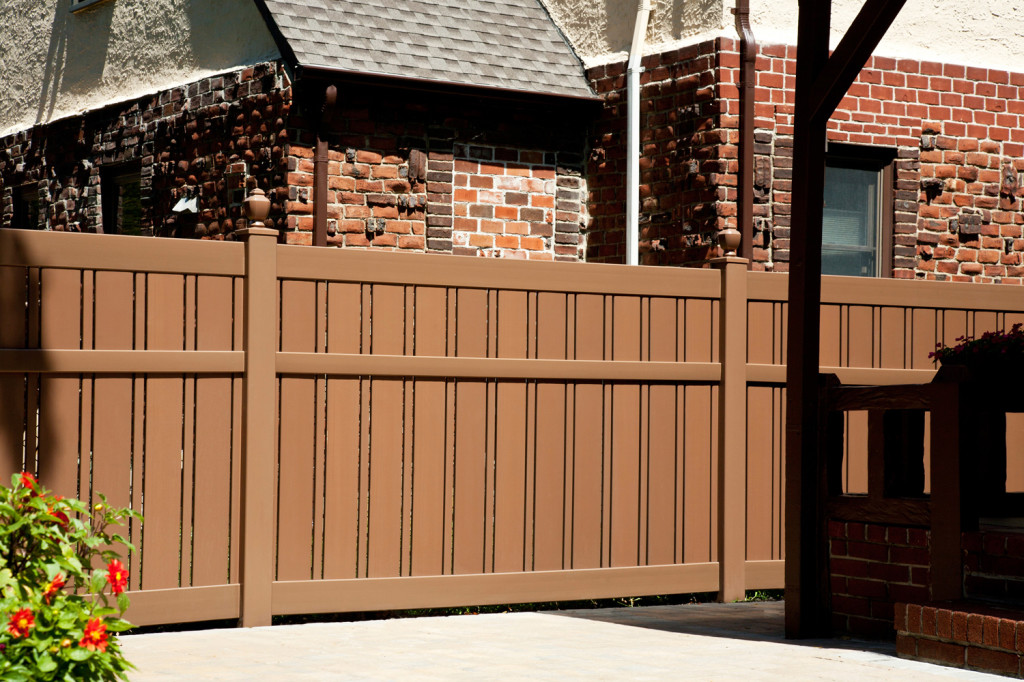 "V500A-6 Semi-Privacy Fence with Alternating 1-1/2"" and 6"" Wide Boards. Shown in Illusions Vinyl Fence's Grand Illusions Color Spectrum Landscape Series Brownstone (E112) #fenceideas #homeideas #backyardideas"