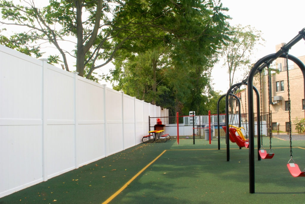 illusions 8 foot high pvc vinyl privacy fence at school