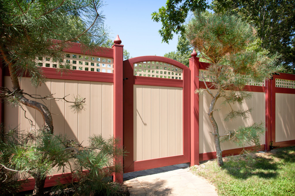 Red and Tan PVC Vinyl privacy fence from Illusions Vinyl Fence
