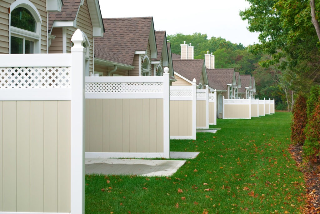 illusions pvc vinyl beige and white privacy fence condo complex