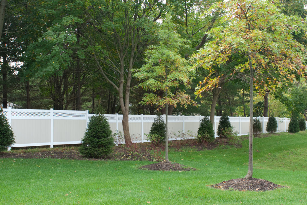 illusions pvc vinyl fence privacy panels green grass