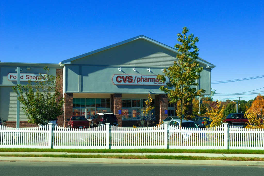 illusions pvc vinyl white picket fence at a cvs pharmacy