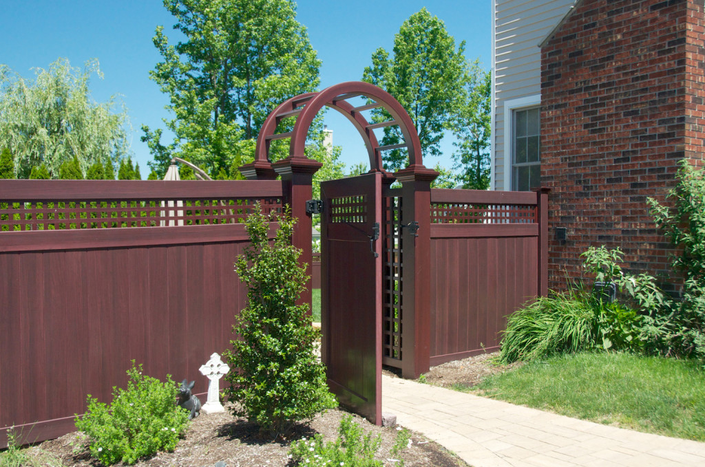 illusions vinyl pvc wood grain mahogany arbor and fence