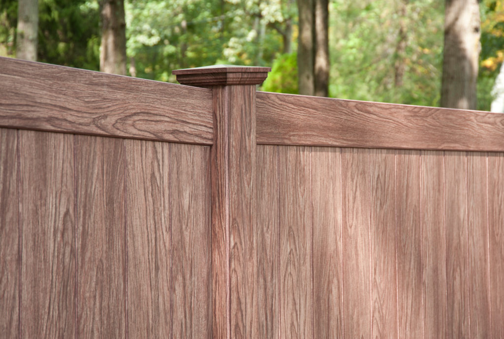 illusions walnut vinyl privacy fence