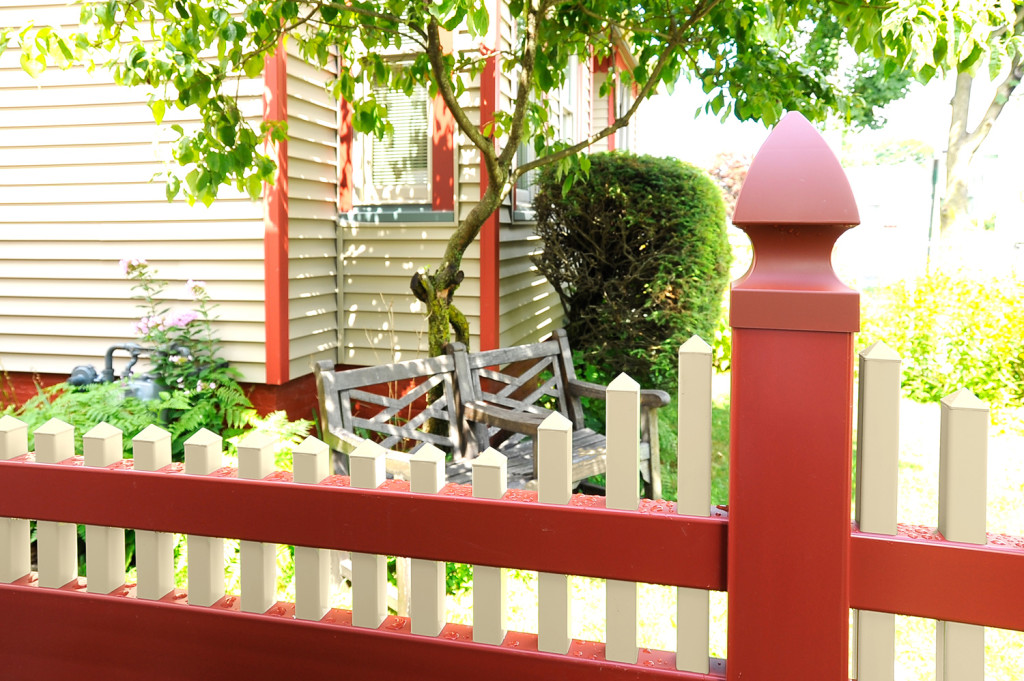red and tan pvc vinyl privacy fence panels