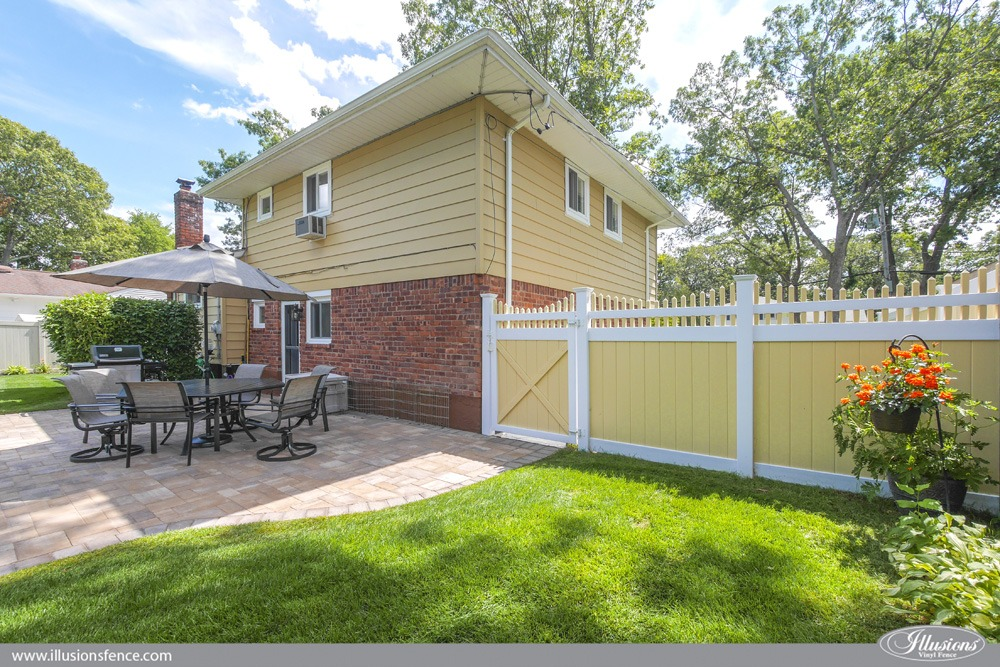 Yellow and white pvc vinyl fence to match home