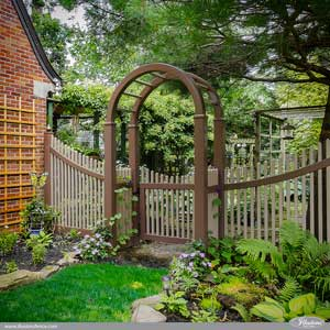 Beautiful Brown and Adobe PVC Vinyl Arbor and Curved Picket Fence from Illusions Vinyl Fence. You can curve, bend, color, mix and match, your fence with Illusions. #fenceideas