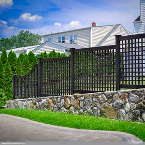 Looking for a great backyard fence idea? How about black PVC vinyl Old English Lattice fence from Illusions Vinyl Fence? Shown here is style VSQL-68 with a 6' to a 4' straight to slope transition section at the end. #fenceideas #backyardideas #homeideas #dreamyard #homedecor