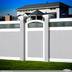 Incredible Gray, White, PVC Vinyl Fence Panels with Green Lattice, an Arched Accent Gate, and Majestic 8 Inch by 8 Inch Posts from Illusions Vinyl Fence. The biggest PVC vinyl fence and deck railing posts on the market. #landscapingideas #homeideas #fenceideas #backyardideas #homedecor