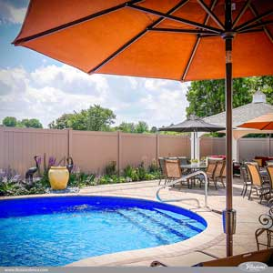 These Gorgeous Tan Colored Vinyl Fence Panels Are Actually Grand Illusions Color Spectrum Adobe (L108) From Illusions Vinyl Fence. They are the perfect vinyl fencing panels for around your pool. The Style is V300-6L108 Tongue & Groove Privacy Fence. #backyardideas #homeideas #fenceideas #homedecor