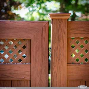 Rosewood PVC vinyl wood grain fence gate from @Illusions Vinyl Fence. Fence style V3215DS-6W104. Small Diagonal Lattice Topper. Matching Uni-Weld Gate VWG3215DS-46W104. #fenceideas