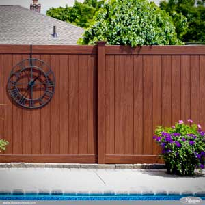 Tongue and Groove Rosewood PVC Vinyl Illusions Privacy Fence Looks Like Stained Wood Fence and is Perfect for Your Pool Area. #fenceideas