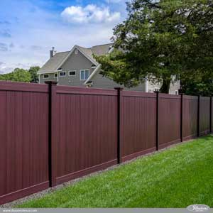 Incredible Wood Grain PVC Vinyl Privacy Fence Panels in Mahogany by Illusions Vinyl Fence. The style shown is a V300-6W101 Tongue and Groove vinyl privacy fence. A perfect good neighbor fence that looks like stained wood fence without the maintenance. #fenceideas #backyardideas #homeideas #homedecor #landscapingideas