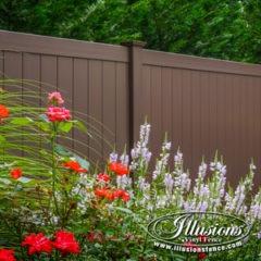 Beautiful Brown PVC Vinyl Privacy Pool Fence from Illusions Vinyl Fence. #fenceideas #fence #illusionsfence #backyardideas #pool #homeideas #landscaping