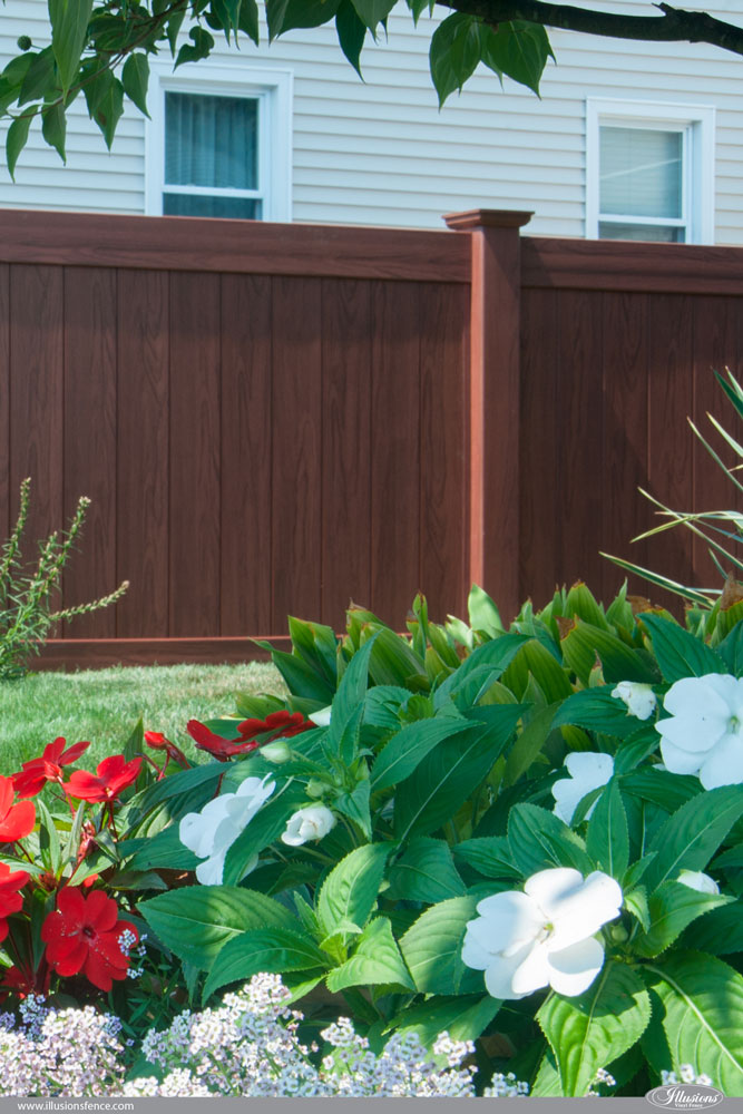 Rosewood Wood Grain Illusions PVC Vinyl Privacy Fence Looks Just Like Real Wood Without the Maintenance. #fenceideas #fence #privacy #backyardideas #homeideas