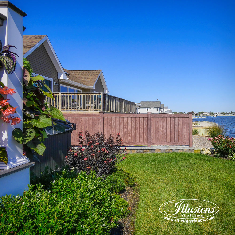 Walnut PVC Vinyl Fence Panels by Illusions Vinyl Fence are a Great Good-Neighbor Fence Idea for Your Home. #fenceideas #fence #vinylfencing #homedecor