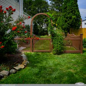 Gorgeous Brown PVC Vinyl Scalloped Picket Fence and Arbor from Illusions Vinyl Fence. #fenceideas #homeideas #backyardideas #fence