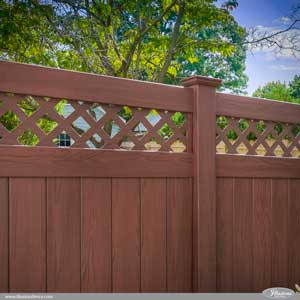 Stunning Rosewood PVC vinyl privacy fence with diagonal lattice topper from Illusions Vinyl Fence is the perfect alternative to stained wood fence. #fenceideas #fence #dreamyard #homeideas