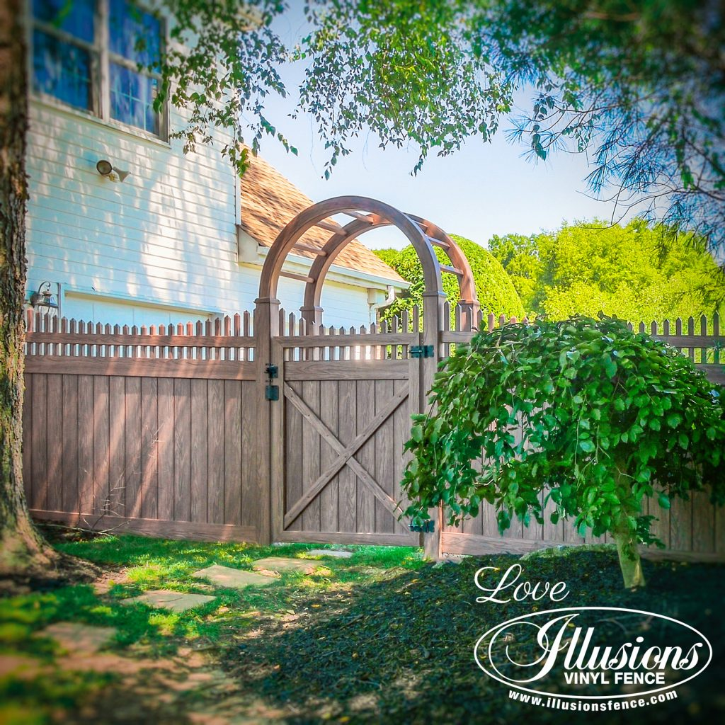 Got to love this rustic looking V3707-6 Illusions vinyl privacy fence with with scalloped picket top and grand arbor shown in Walnut #fence #fences #fencing #vinylfence #vinylfencing #fencepanels #fenceideas #homeideas #homedecor #backyardideas #privacyfence #privacyfences #poolfence #poolfences #longisland #longislandny #newyork #connecticut #rhodeisland #massachusetts #connecticut #pennsylvania #newjersey #fencecompany #bestfence #fencecontractor #fenceinstaller #yardfence